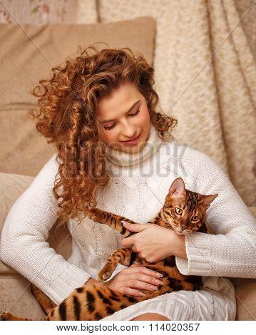 Girl Hugs Bengal Cat.
