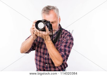 Pretty Aged Photographer Making A Photo