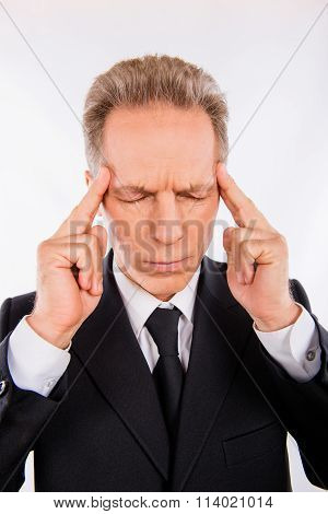 A Concentrated Man With Headache Is Losting In His Thoughts