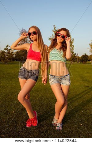 Two Young Sexy Girls With Shapely, Toned Body In The Park