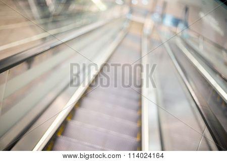 Escalator blur background with bokeh