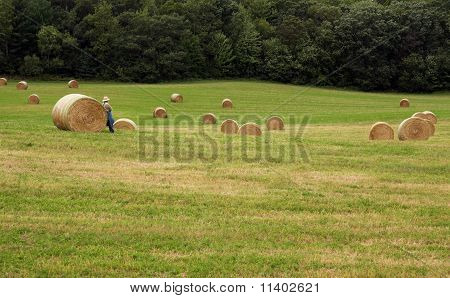 Round Bales And Farmer