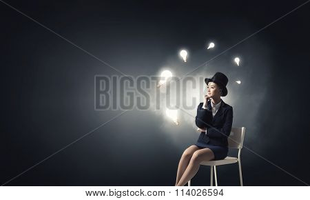 Girl in black cylinder