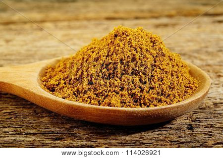 Garam Masala Powder In Wooden Spoon