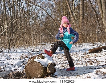 Little Girl In The Forest In Wintertime