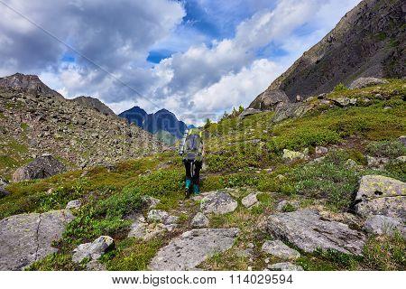 Hiking. Woman Walks On A Mountain Path