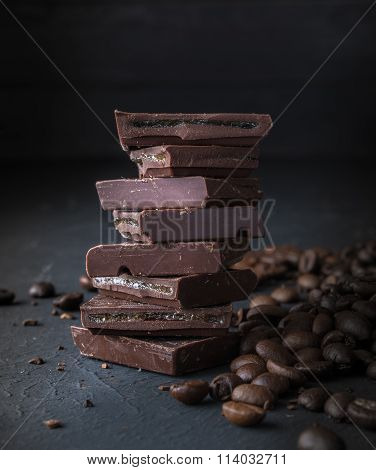 Fresh Roasted Coffee Beans And Stack Of Brown Chocolate.