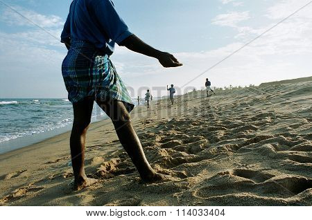 Indian fishermen fishing off Indian beach