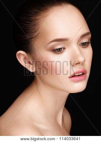 Portrait Of Tender Young Beautiful Girl With A Clean Healthy Skin.