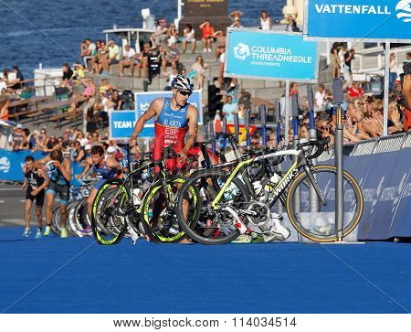 Triathletes Fernando Alarza Parking The Cycle In The Transition Zone
