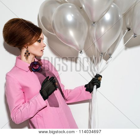 Young Girl In A Pink Raincoat With Balloons