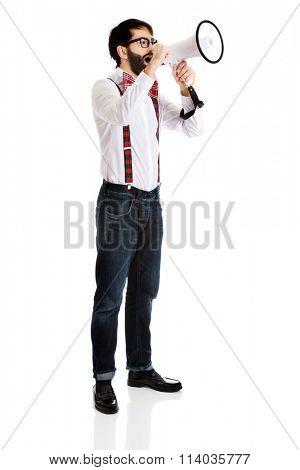 Man wearing suspenders with megaphone.