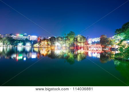 Hoan Kiem lake view at twilight with Ngoc Son old temple and The Huc bridge