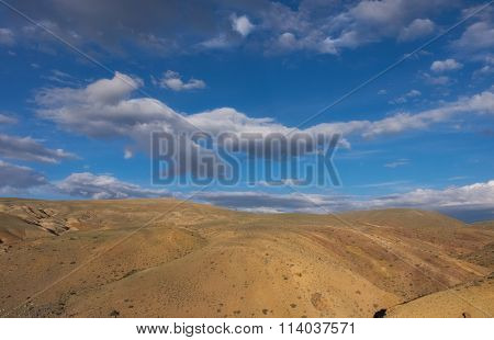 Red Earth And Blue Sky