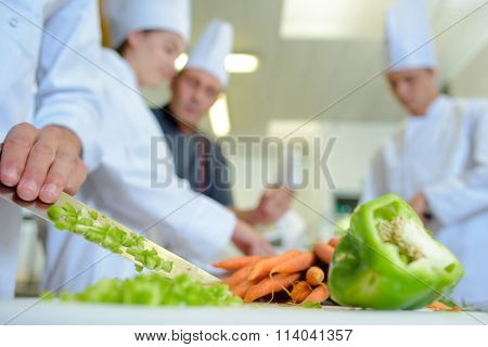 Peppers being wiped off blade of knife