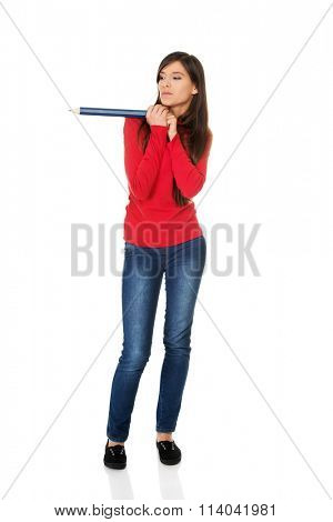 Beautiful young with a big pencil.