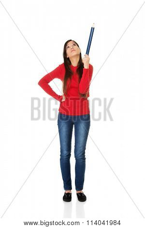 Beautiful woman pointing up with a big pencil.