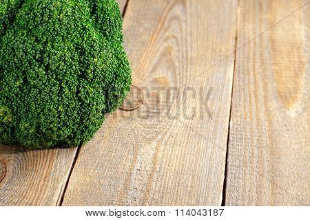 Raw fresh green broccoli on wooden background