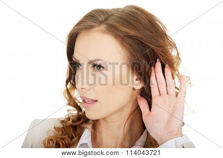Beautiful businesswoman overhears.