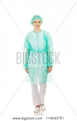 Female doctor in protective clothing.
