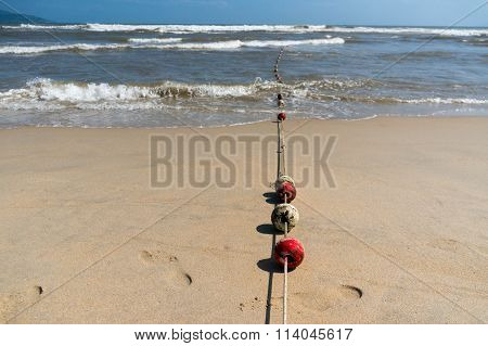 Buoys On A Rope Leading Into The Ocean