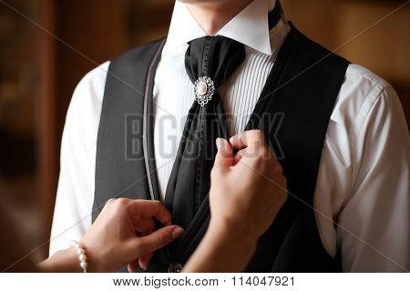 Groom In White Shirt And Black Trousers