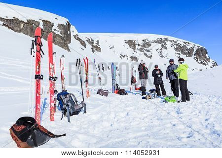 Group Of Tourists Rests And Drinks Tea During Their Ski Hike In The  Mountains Of The Arctic, Hibiny