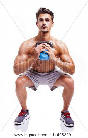 Fit man doing squats, isolated over a white background