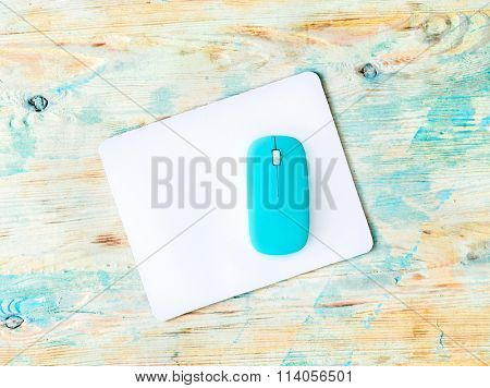 white pad with blue mouse