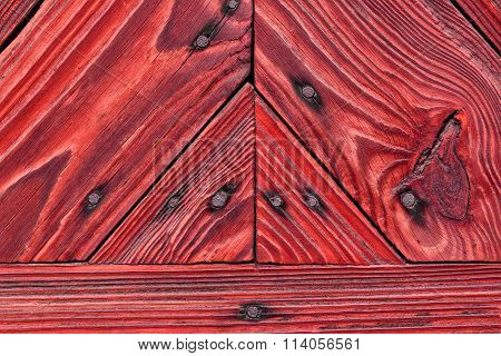 Red boards, a wooden background