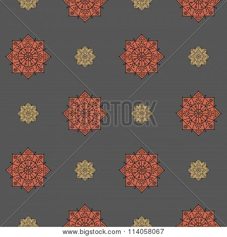 Seamless pattern with small and big ethnic rosettes on a grey background