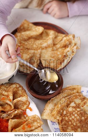 Pancakes with red caviar at home