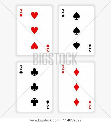 Playing Cards Showing Threes From Each Suit