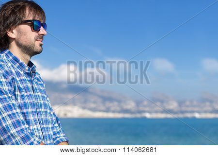 Side View Of Bearded Young Man In Sunglasses