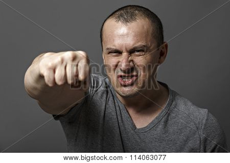 Angry Man Shows His Fist