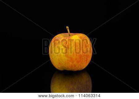 Apple against black background