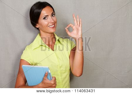 Confident Lady Showing Ok Sign And Holding Tablet