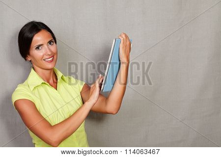 Hair Back Lady Smiling And Carrying Tablet