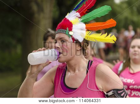 Woman drinking water on race for life