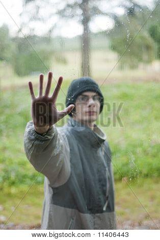 Hand Pressing Against Window