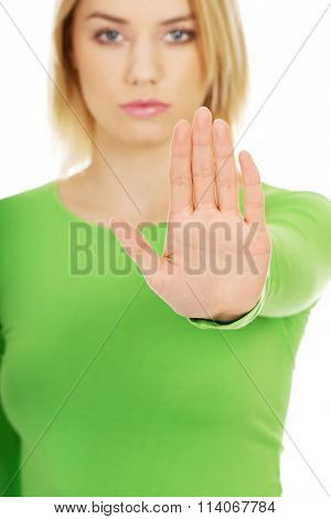 Young woman with stop gesture.