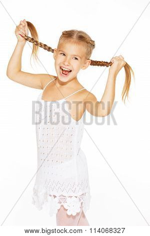 Funny little girl with pigtails