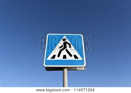 Metal Pedestrian Sign And Blue Sky
