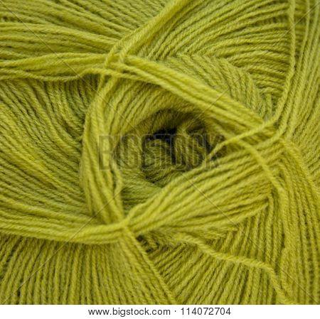 Green wool yarn ball. Wool thread.