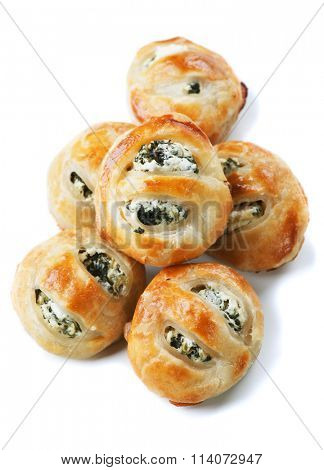Puff pastry filled with spinach and cheese isolated on white background
