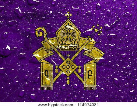flag of Armenian Apostolic Church with rain drops