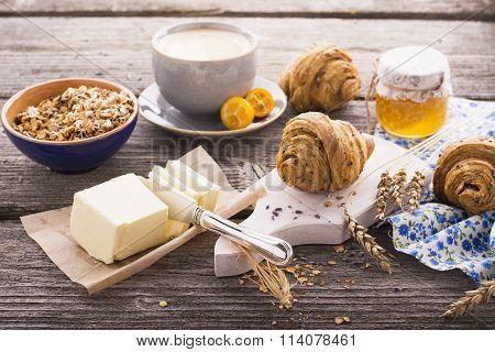 Breakfast with honey butter fresh croissants
