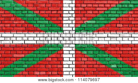 flag of Basque Country painted on brick wall