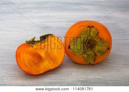 Persimmons whole and halved