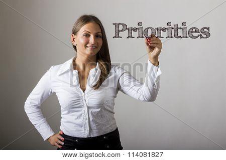 Priorities - Beautiful Girl Writing On Transparent Surface